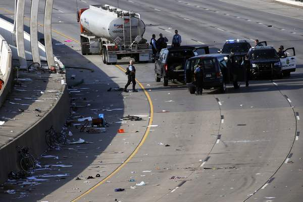Police clear the area where a tanker truck rushed to a stop among protesters on an interstate Sunday, May 31, 2020, in Minneapolis. (AP Photo/John Minchillo)