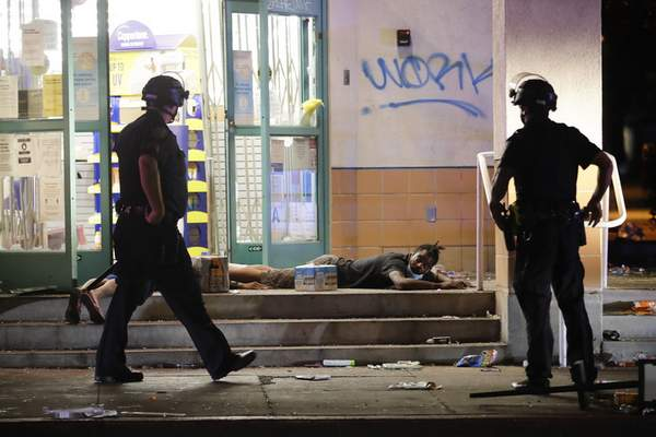 A man is arrested outside a CVS store Sunday, May 31, 2020, in Santa Monica, Calif., during unrest and protests over the death of George Floyd, who died May 25 after he was pinned at the neck by a Minneapolis police officer. (AP Photo/Marcio Jose Sanchez)