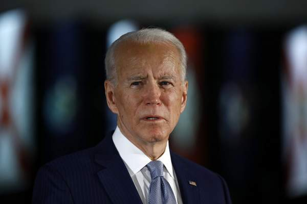 FILE - In this March 10, 2020, file photo, Democratic presidential candidate former Vice President Joe Biden speaks to members of the press at the National Constitution Center in Philadelphia. (AP Photo/Matt Rourke, File)