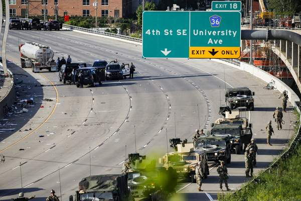 A semi-truck involved in an incident with protesters on Highway 35W is surrounded by authorities, Sunday, May 31, 2020, in St. Paul, Minn. (AP Photo/John Minchillo)