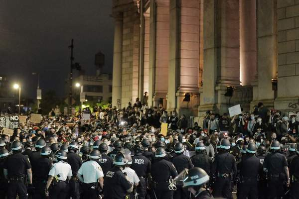 Police block protesters from exiting the Manhattan Bridge in New York, Tuesday, June 2, 2020. New York City extended an 8 p.m. curfew all week as officials struggled Tuesday to stanch destruction and growing complaints that the nation's biggest city was reeling out of control night by night. (AP Photo/Seth Wenig)