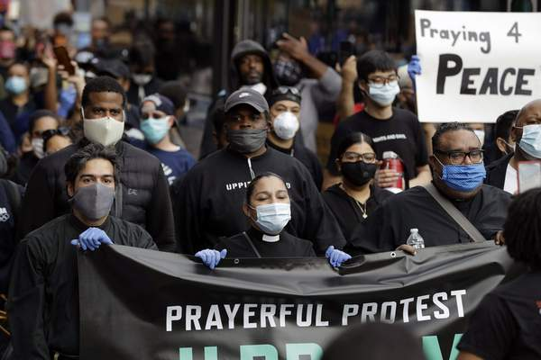 Members of the clergy lead protesters in the Prayerful Protest march for George Floyd, Tuesday, June 2, 2020, in the Brooklyn borough of New York. Floyd died after being restrained by Minneapolis police officers on Memorial Day, May 25. (AP Photo/Frank Franklin II)