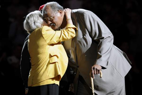 FILE - In this April 6, 2013, file photo, former Washington Bullets basketball player and Hall of Famer Wes Unseld, right, is greeted by Irene Pollin, left, wife of the late Bullets' owner Abe Pollin, during a ceremony to celebrate the 35th anniversary of the Bullets only NBA championship, during halftime of an NBA basketball game between the Washington Wizards and the Indiana Pacers, in Washington. Unseld, the workmanlike Hall of Fame center who led Washington to its only NBA championship and was chosen one of the 50 greatest players in league history, died Tuesday, June 2, 2020, after a series of health issues, most recently pneumonia. He was 74. (AP Photo/Nick Wass, File)
