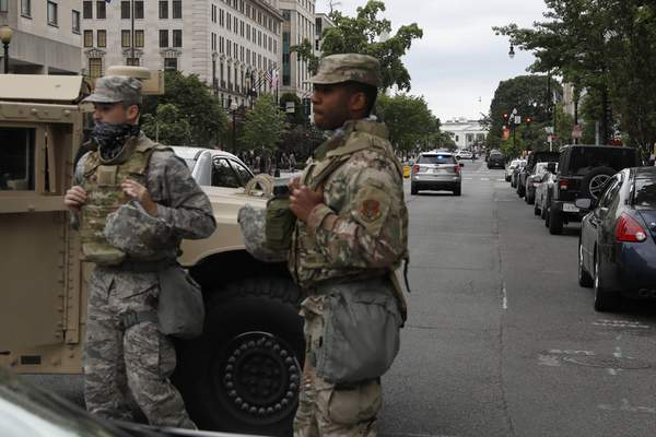 Members of the DC National Guard block an intersection on 16th Street as demonstrators gather to protest the death of George Floyd, Tuesday, June 2, 2020, near the White House in Washington. (AP Photo/Jacquelyn Martin)