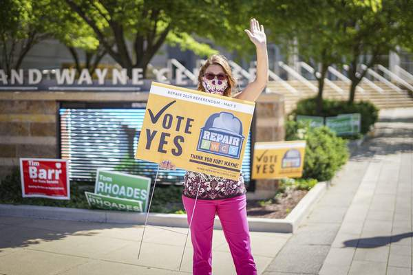 Mike Moore   The Journal Gazette Kara Miller shows support on Tuesday for the Repair FWCS referendum outside the polling location at Grand Wayne Center. The referendum was on the ballot to help Fort Wayne Community Schools get $130 million to complete renovations at its schools.
