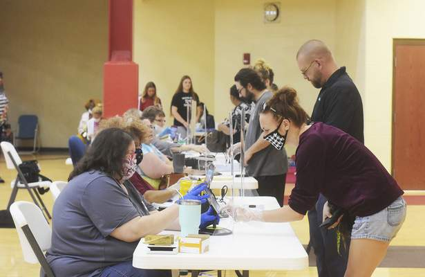 Katie Fyfe | The Journal Gazette Voters check in Tuesday at North Side High School to cast their ballot in the Indiana primary.