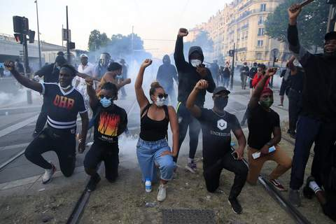 America Protests France Associated Press  Protesters kneel during a demonstration Tuesday in Paris against police violence and racial injustice. (Michel EulerSTF)
