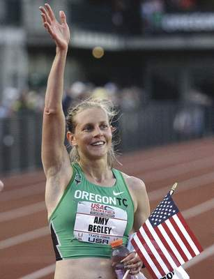 Associated Press Amy Begley waves to the crowd after crossing the finish line June 25, 2009, in Eugene, Ore.