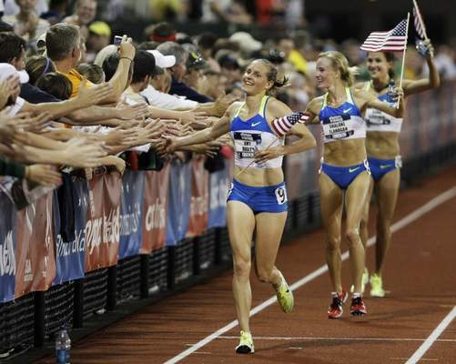 File photo  Amy Yoder Begley greets the crowd after she finished third at the 2008 Olympic Trials, qualifying for the Olympic Games.