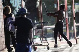 America Protests-Small Business Devastation Associated Press A man breaks a window of a business with a baseball bat Thursday in St. Paul, Minn., during protests over the killing of George Floyd last week in Minneapolis. (John MinchilloSTF)