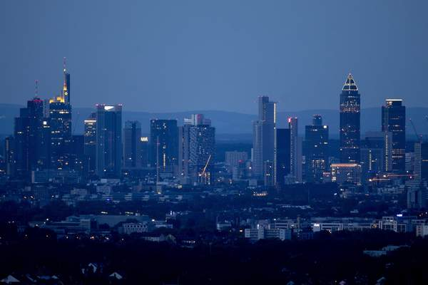 Associated Press The buildings of the banking district are seen Sunday in Frankfurt, Germany.