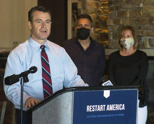 Michelle Davies | The Journal Gazette As Catablu owners Michael and Maureen Catalogna listen, Sen. Todd Young discusses his RESTART Act at their restaurant on May 26.