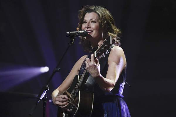 FILE - In this Oct. 15, 2019 file photo, singer Amy Grant performs during the Dove Awards in Nashville, Tenn. (AP Photo/Mark Humphrey, File)