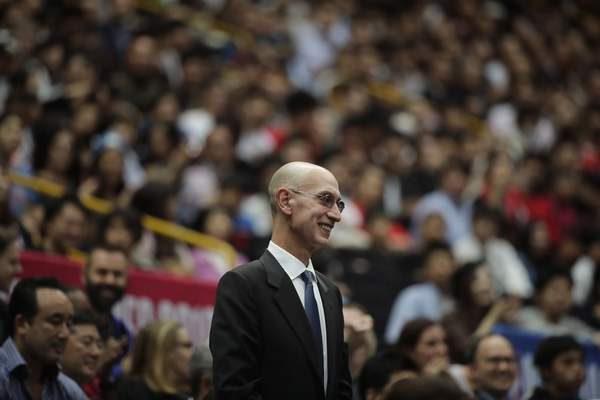 FILE - In this Oct. 8, 2019 file photo, NBA Commissioner Adam Silver is introduced during an NBA preseason basketball game between the Houston Rockets and the Toronto Raptors in Saitama, near Tokyo. (AP Photo/Jae C. Hong, File)