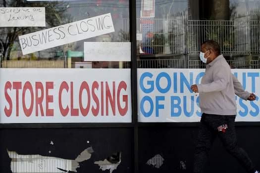 ADP Jobs Report Associated Press A man looks at signs of a closed store due to the coronavirus pandemic in Niles, Ill. U.S. businesses shed 2.76 million jobs in May, as the economic damage from the outbreak stretched into a third month.  (Nam Y. HuhSTF)