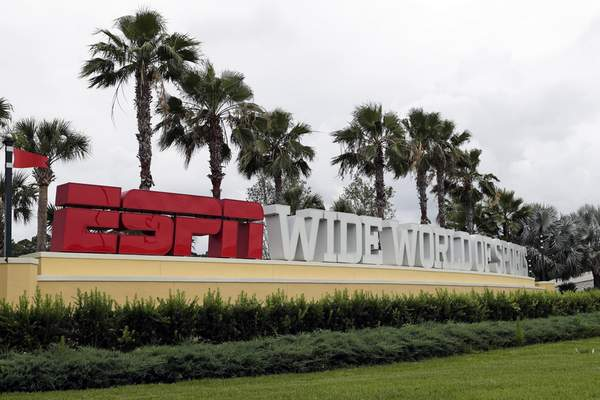 A sign marking the entrance to ESPN's Wide World of Sports at Walt Disney World is seen Wednesday, June 3, 2020, in Kissimmee, Fla. (AP Photo/John Raoux)