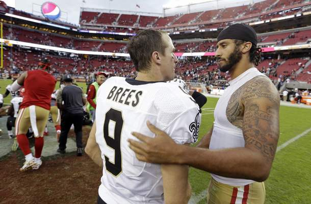 Associated Press Saints quarterback Drew Brees meets with 49ers quarterback Colin Kaepernick after a November 2016 game. Kaepernick knelt that season during the national anthem to protest police brutality.
