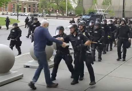America Protests Buffalo Associated Press In this image from TV news video, a Buffalo, N.Y., police officer appears to shove a man who walked up to officers Thursday after a protest. Video showed him falling and striking his head. (Mike DesmondHONS)