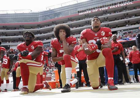 Catching On To Kaepernick Associated Press Quarterback Colin Kaepernick, center, kneels with 49ers teammates Eli Harold, left, and Eric Reed during the national anthem before a 2016 game. Kaepernick knelt to protest racial injustice. (Marcio Jose SanchezSTF)
