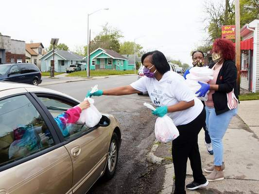 FILEMembers of the nonprofit Sistarz & Sistartz hand out meals during a food drive hosted last month by Big Momma's Kitchen, Sistarz & Sistarz, Black Women of Excellence, and the Human Agricultural Cooperative outside Big Momma's Kitchen on Oxford Street.