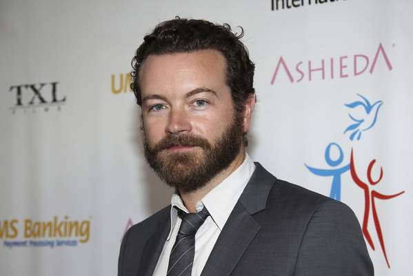 FILE - In this March 24, 2014 file photo, actor Danny Masterson arrives at Youth for Human Rights International Celebrity Benefit in Los Angeles. Masterson, known for his roles in That '70s Show and The Ranch, has been charged with raping three women, Los Angeles County District Attorney's officials announced Wednesday. (Annie I. Bang/Invision/AP, File)