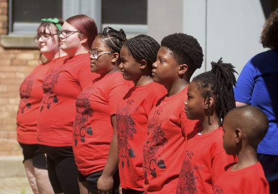 Katie Fyfe | The Journal Gazette  Art Leader Center student leaders being developed to become renaissance leaders are present at both the Keller Williams downtown courtyard area and at Foster Park for the Juneteenth Celebration on Friday.