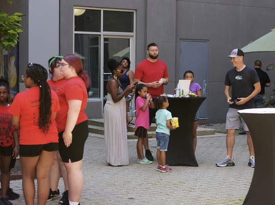 Katie Fyfe | The Journal Gazette Crowds hang out and enjoy the Juneteenth Celebration at Keller Williams downtown courtyard on Friday morning, June 19th, 2020.