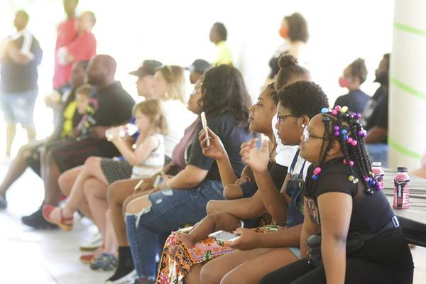 Katie Fyfe | The Journal Gazette  A crowd forms at Foster Park to celebrate Juneteenth on Friday.