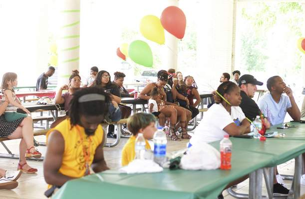 Katie Fyfe | The Journal Gazette  A crowd forms in one of the pavilions at Foster Park to celebrate Juneteenth on Friday.