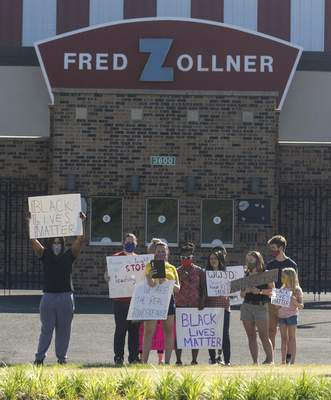 Photos by Michelle Davies   The Journal Gazette Protesters, who say they are Concordia graduates, stand outside Zollner Stadium on Friday morning.