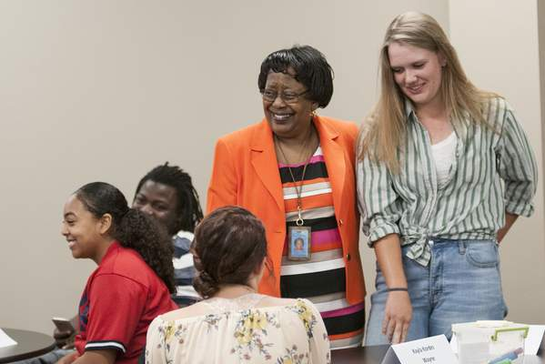 Cathie Rowand | The Journal Gazette FWCS Superintendent Dr. Wendy Robinson talks with students as Wayne High School student Molly Brehm introduces herself during a student advisory council meeting.