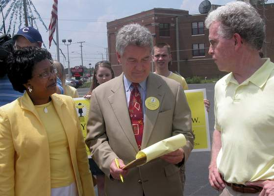File  Fort Wayne Community Schools Superintendent Wendy Robinson, left, and petition drive leader John Peirce, right, stand with former Fort Wayne mayor Paul Helmke after he signed a yellow petition for the remonstrance.