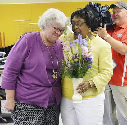 File  St. Joseph Central Elementary School music teacher Laura McCoy, left, receives FWCS teacher of the year from Fort Wayne Community Schools Superintendent Dr. Wendy Robinson.