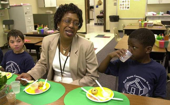 File  FWCS Superintendent Wendy Robinson visits with third graders Christian Pippins, right, and Chance Scroggs during a healthy living class at the Indiana Village summer clubhouse.