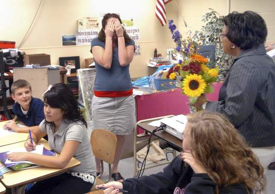 File  Northwood Middle School teacher Michelle White covers her face in surprise and embarassment as Superintendent Wendy Robinson, right, announces that she's the FWCS teacher of the year.