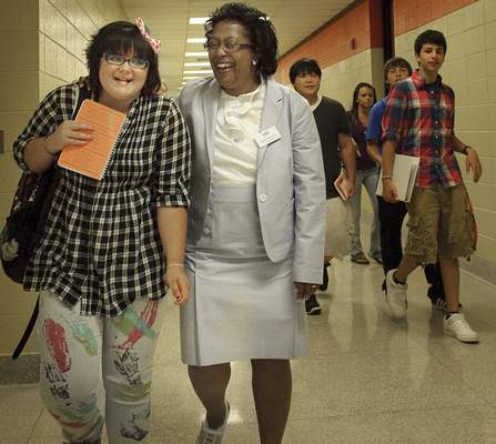 Fort Wayne Community Schools Superintendent Dr. Wendy Robinson, walks with freshman Dakota Kaiser, 14, on her way to class Monday morning at Northrop High School on the first day of school.