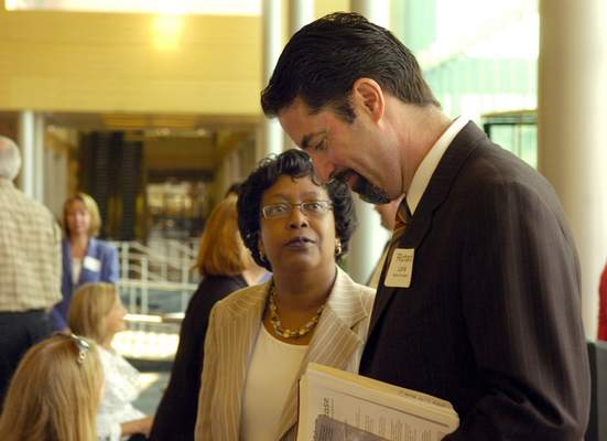 FWCS Superintendent Wendy Robinson speaks with Richard Laine from the Wallace Foundation Director of Education after announcing the renewal of a $5 million grant to FWCS at the Grand Wayne Center Wednesday.