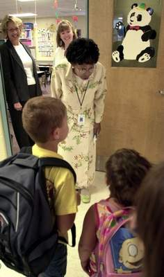 File  Acting FWCS Superintendent Wendy Robinson greets students at Price Elementary School on Monday, the first day of the district's school year.