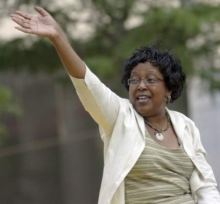 Dr. Wendy Robinson, co-grand marshall of the Three Rivers Parade waves to the crowd.