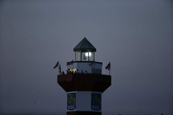 Fans watch the RBC Heritage from a lighthouse Sunday. No fans were  on the course because of the COVID-19 pandemic.
