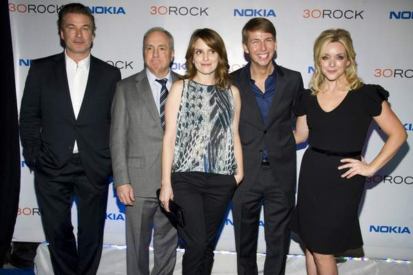 FILE - In this Dec. 20, 2012 file photo, Alec Baldwin, from left, Lorne Michaels, Tina Fey, Jack McBrayer and Jane Krakowski attend the 30 Rock farewell wrap party in New York. (Photo by Charles Sykes/Invision/AP, File)