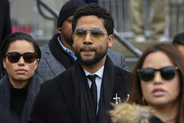 FILE - In this Feb. 24, 2020 file photo, former Empire actor Jussie Smollett leaves the Leighton Criminal Courthouse in Chicago, after an initial court appearance on a new set of charges alleging that he lied to police about being targeted in a racist and homophobic attack in downtown Chicago early last year. (AP Photo/Matt Marton File)
