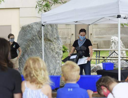 Katie Fyfe | The Journal Gazette  Local artist and art teacher Erin Patton-McFarren teams up with Science Central to show visitors how to create beautiful cyanotypes on Saturday.