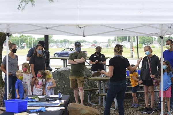Katie Fyfe | The Journal Gazette  Science Central partners with local artist and art teacher, Erin Patton-McFarren, to create beautiful cyanotypes with visitors on Saturday.