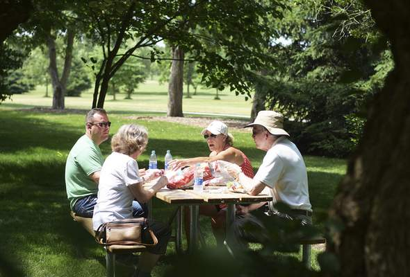Katie Fyfe | The Journal Gazette The Beckers and the Haynes enjoy a picnic together at Foster Park on Friday, June 26th, 2020.
