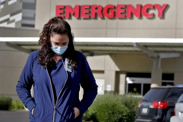 Associated Press Caroline Maloney stands outside Osborn Medical Center in Scottsdale, Ariz., at the end of her overnight shift Friday. Arizona has more than 70,000 confirmed coronavirus cases.