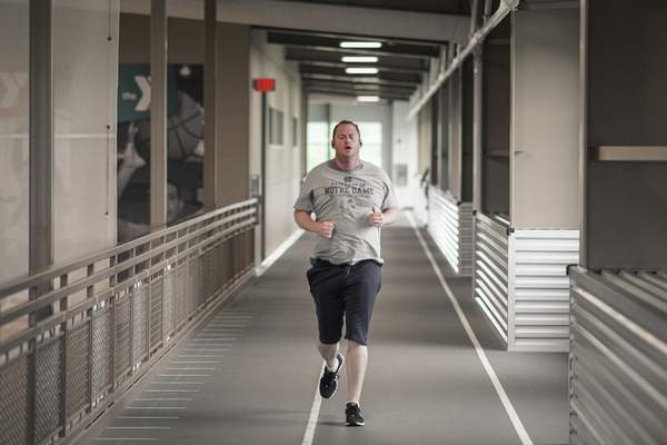 Ryan Morgan runs the  track at the Jackson R. Lehman Family YMCA. Y officials are seeing people slowly return.