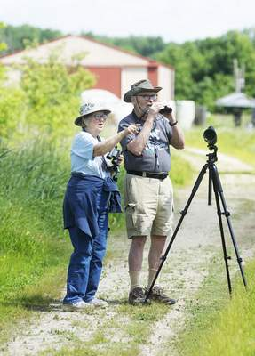 Katie Fyfe | The Journal Gazette Cynthia and Ed Powers bird watch together at  Eagle Marsh Nature Preserve on  June 11.
