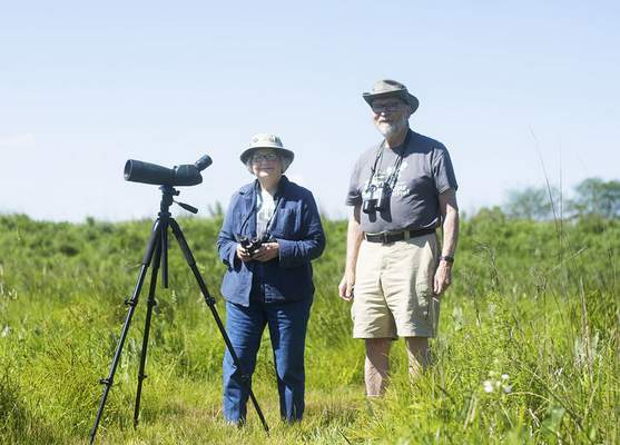 Katie Fyfe | The Journal Gazette Volunteers Cynthia and Ed Powers keeps track of all the bird species spotted at Eagle Marsh Nature Preserve. They also lead birdwatching hikes.
