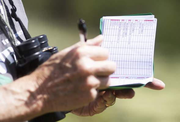 Katie Fyfe | The Journal Gazette Ed Powers keeps track of the different birds he sees and hears during bird watching at the Eagle Marsh Nature Preserve on Thursday, June 11th, 2020.
